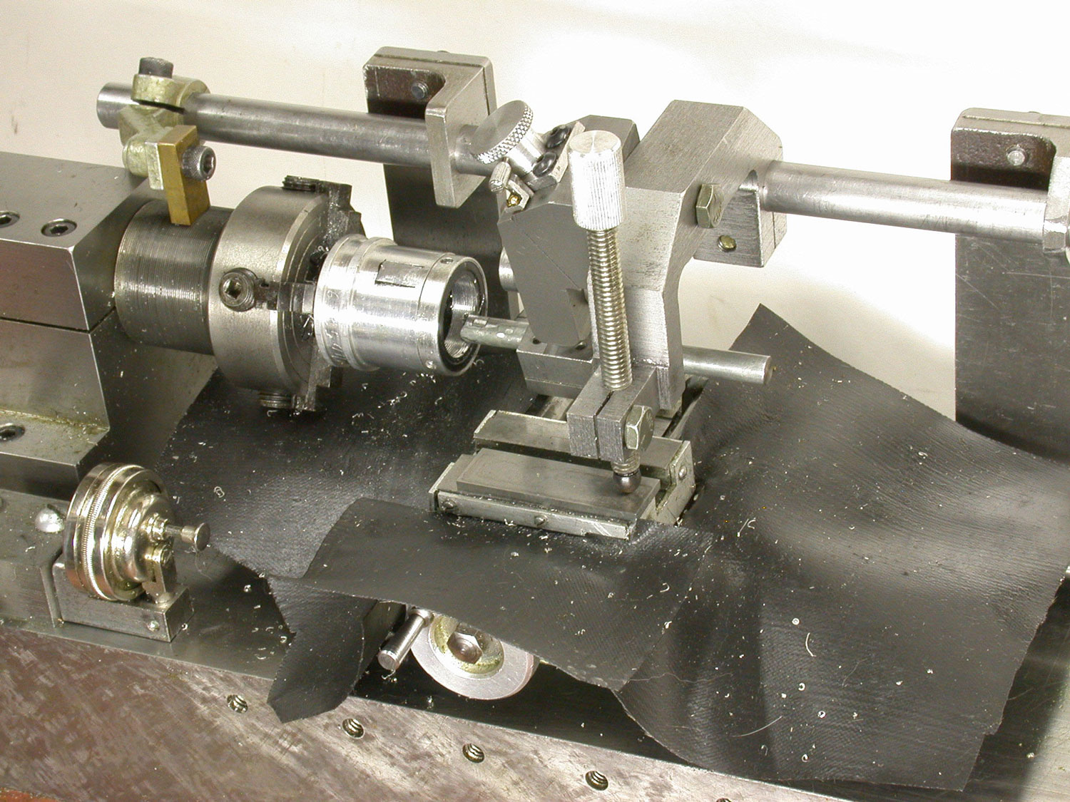 An Adjustable Threading Feed Attachment for a Lathe Without