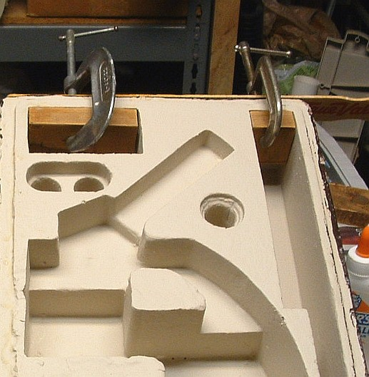 Figure 4. Gluing inside wood support pieces for handle. This photo also shows the finished inside coating of HotWire Foam Coat with Bounce, covered with one coating of almond colored flat latex paint.