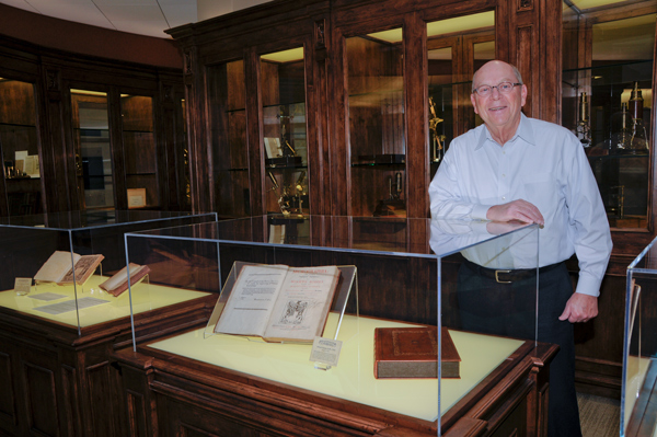 Don Brooks with First Edition of Micrographia in the Brooks Collection