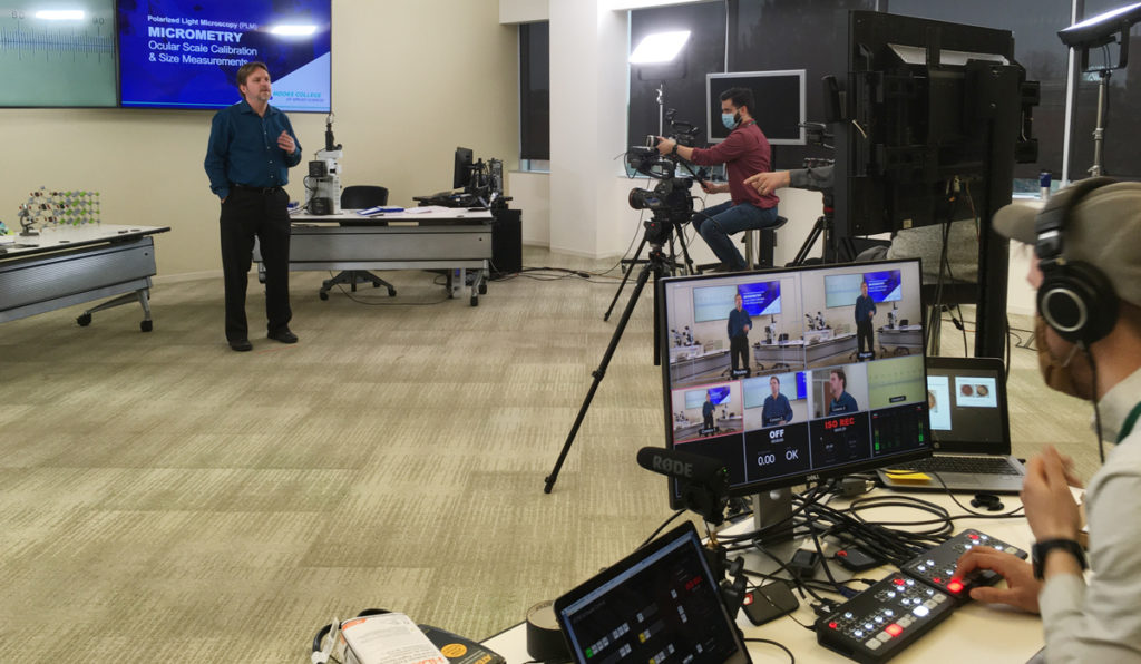 A view of the professional film crew's multi-camera monitor capturing microscopy instructor
