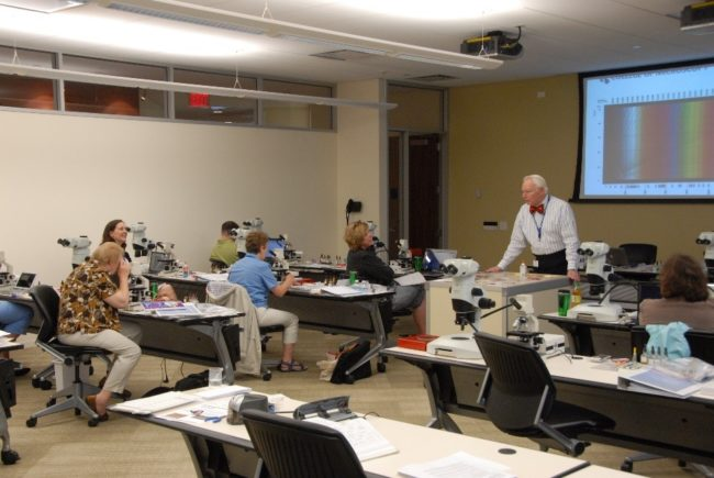John Gustav Delly lecturing to the science teachers during Microscopy Camp.