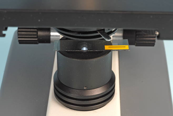inserting polarizing film into the light path